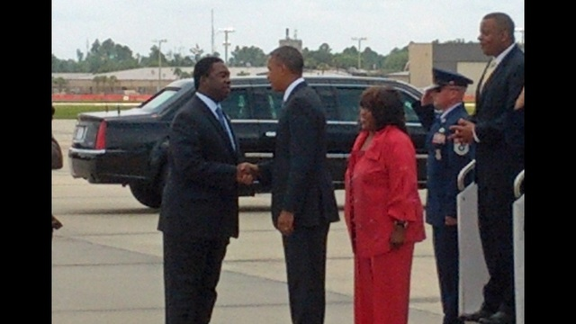 Mayor, president shake hands