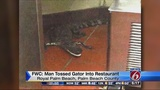 Florida man accused of throwing gator through drive-thru window