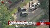 Armed person barricaded in home, Orange County deputies say