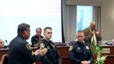 Officers honored for saving child trapped under overturned boat