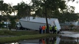 Semi gets stuck after road floods