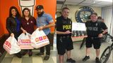Local businesses team up to surprise OPD officers with custom doughnuts