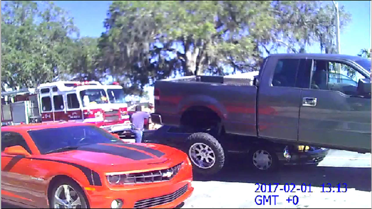 Man Parks Truck On Top Of Car To Defend Family