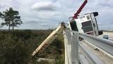 Crane truck tips over on Pineda Causeway overpass