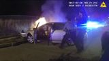 WATCH: Police save driver from burning car