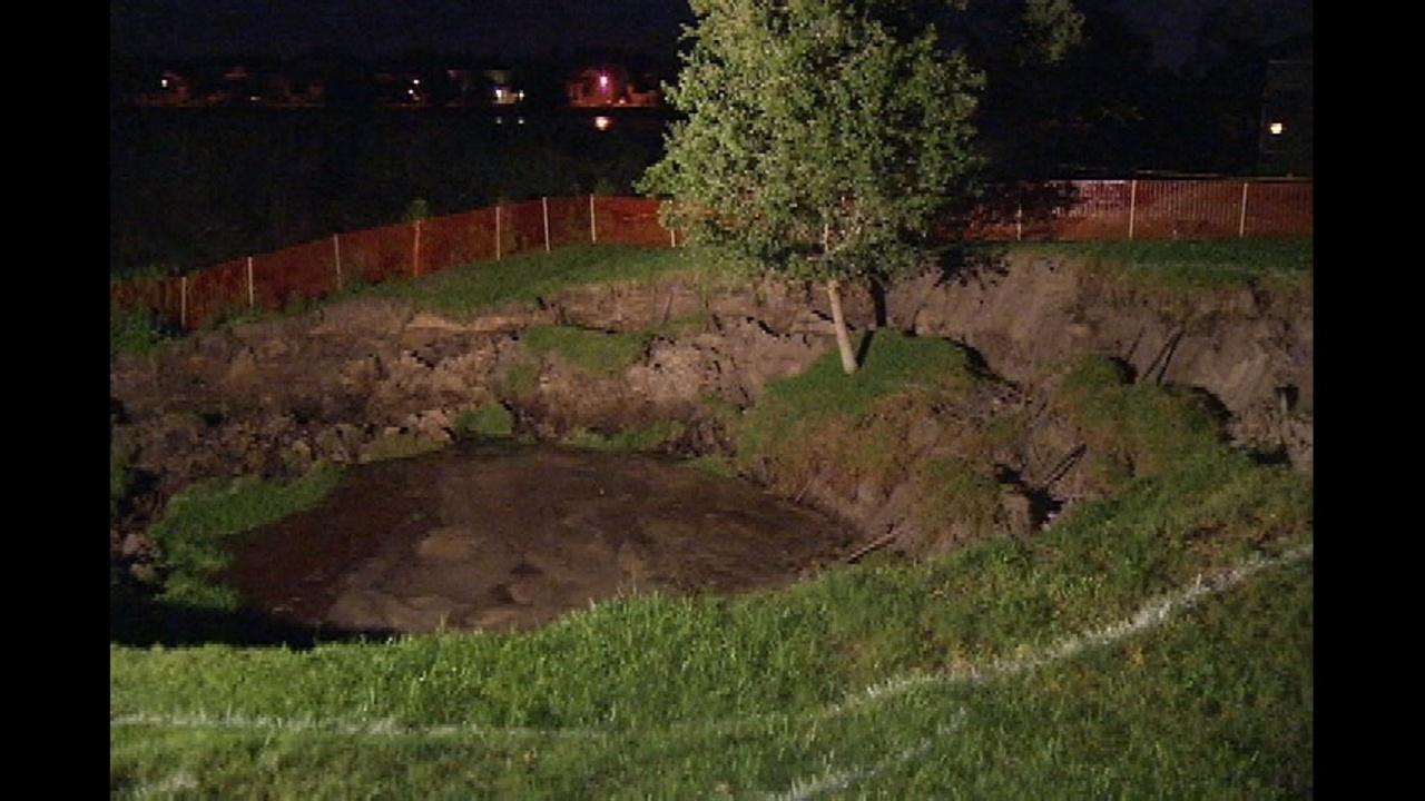 sinkhole still growing homes on edge