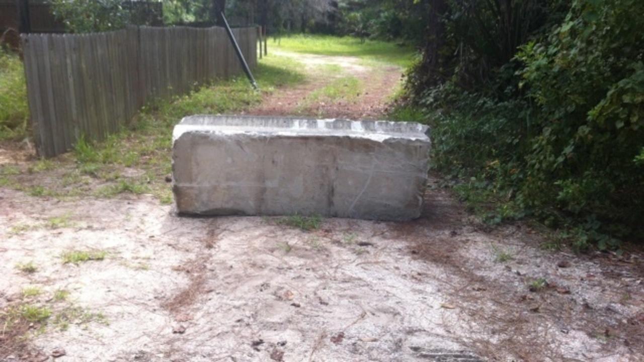 Concrete barrier blocks volusia co woman 39 s driveway for Temperature to pour concrete driveway
