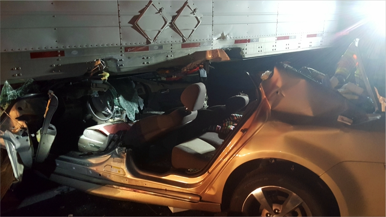 3 Passengers Trapped After Vehicle Collides With Tractor Trailer