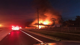 Crews battle fire at abandoned car repair shop in Polk County