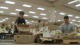 Volunteers pack Ocoee HS, preparing to spread Thanksgiving cheer