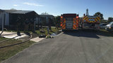 Firefighters work to put out utility room fire in Micco, officials say
