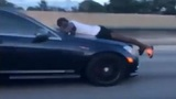 Video shows man riding on hood of car going 70 mph on I-95 in Florida