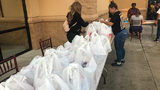 Group gives 300 turkeys to families in need in Pine Hills