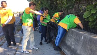 Church volunteers clean up street to spread kindness