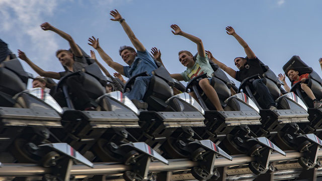 Unbelievable catch: Roller coaster rider catches stranger's cellphone mid-ride