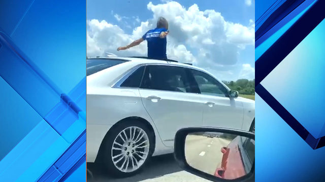 Florida man caught on camera standing in sunroof while driving on Interstate 4
