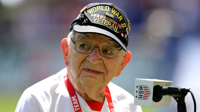 Watch as WWII veteran, 96, performs national anthem for captivated crowd