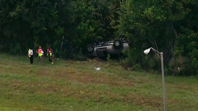 Car flipped over in woods