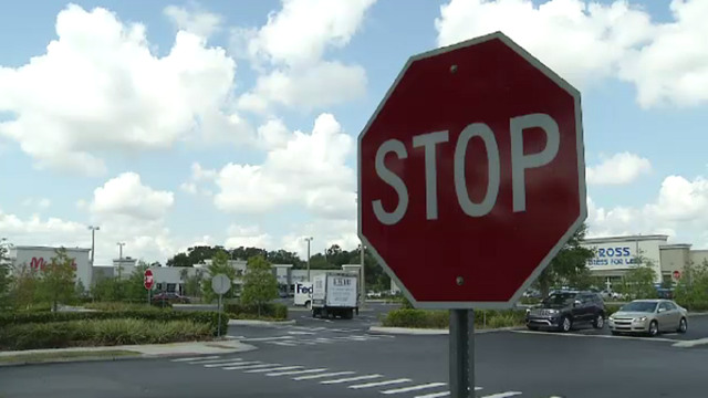 Here's when you're required to stop in parking lots