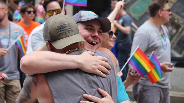 These Pride paradegoers got the best dad embrace from a complete stranger