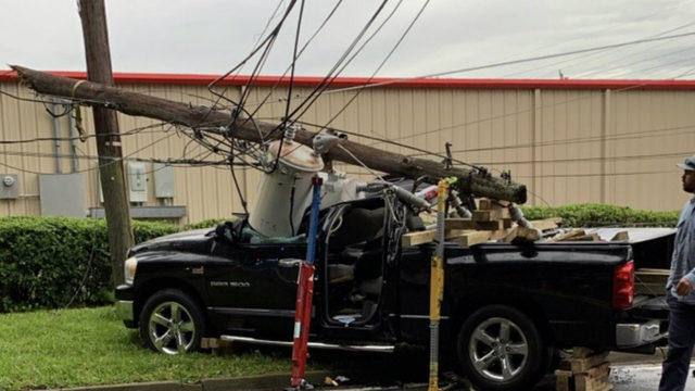 Road closed in Sanford after car strikes light pole, police say