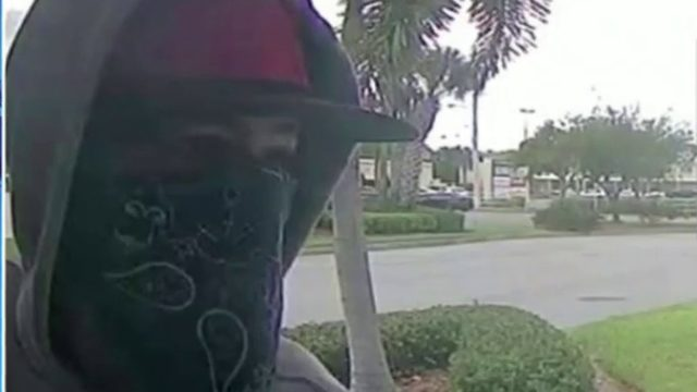 Masked man ambushes, robs woman at Brevard ATM