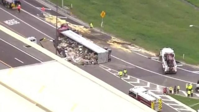 Tractor-trailer hauling trash overturns in Orange County