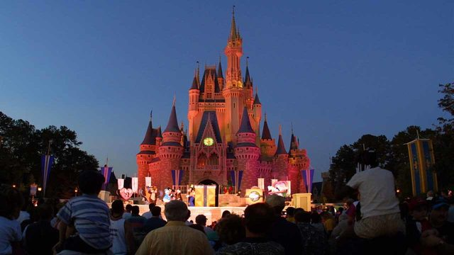 Disney holds sunrise yoga session in front of Cinderella's castle