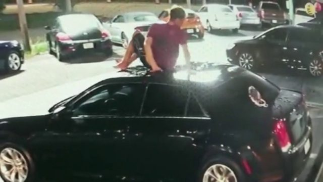 Video shows man falling off roof onto car