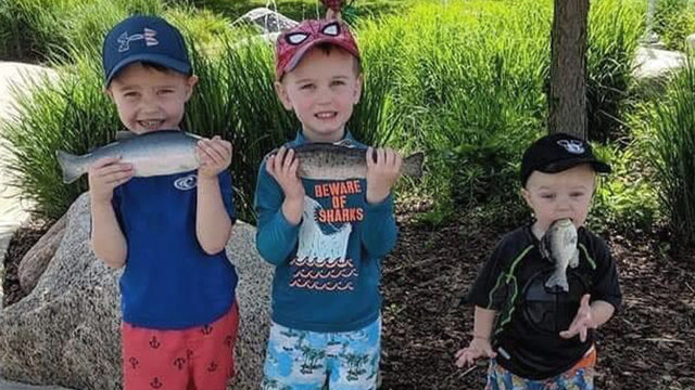 Mom's photo of sons holding fish goes viral