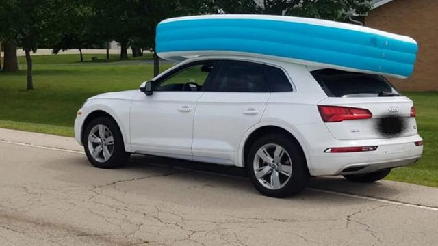 Mom busted for driving while kids ride in pool on top of car