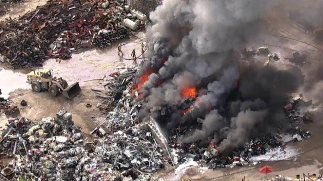 WATCH LIVE: Large trash fire burns at Apoka recycling yard