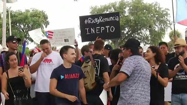 Large group protests in Orlando, calling for Puerto Rico Gov. Rossello…