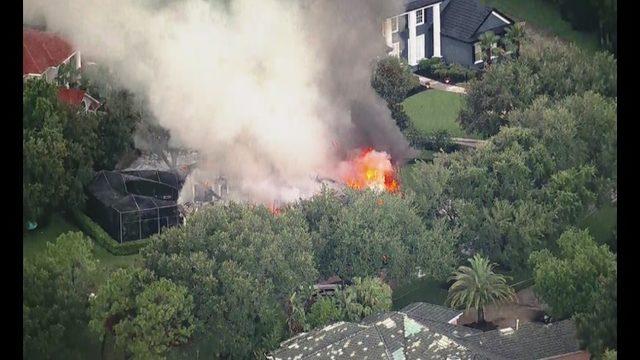 Orange County fire crews fighting blaze at house near Windermere
