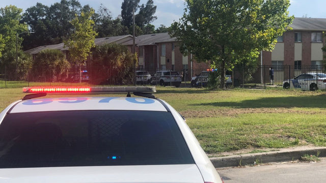 Woman crashes into building after being shot in Orlando