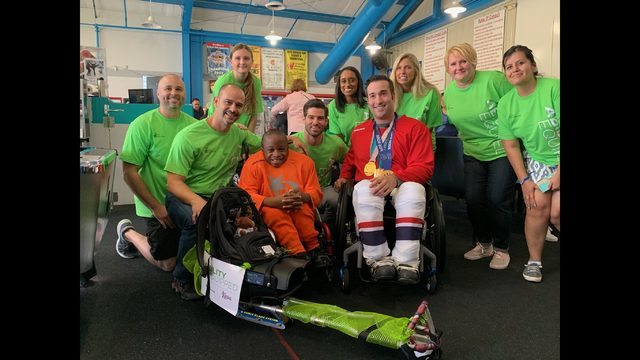 Local adaptive hockey player surprised with customized sled
