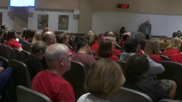 Teachers speak to district officials after voting down new contract in…