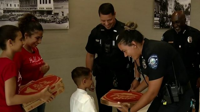 Sanford boy who called 911 for pizza returns the favor to officers who delivered