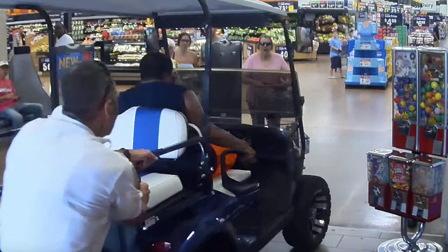VIDEO: Man drives golf cart through crowded entrance at Florida Walmart