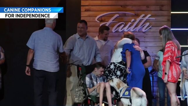 Canine Companions for Independence graduates walk the stage