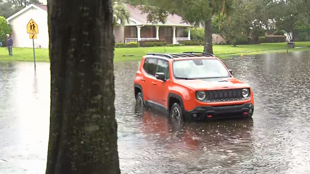 Dozens of drivers need rescuing after rain causes flooding in Orange County