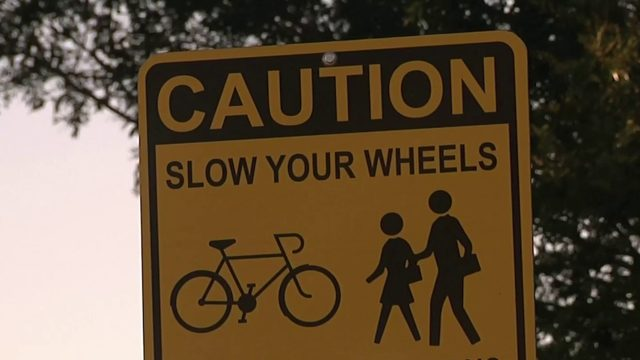 Father pushes to have 'no bikes' signs removed from public park