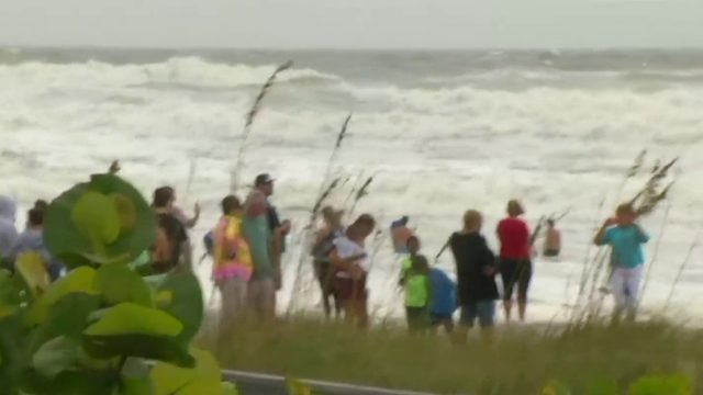 Despite warnings, crowds turn out at Florida beaches ahead of Dorian