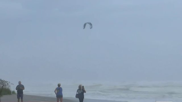 Surfer braves waves as winds pick up ahead of Hurricane Dorian