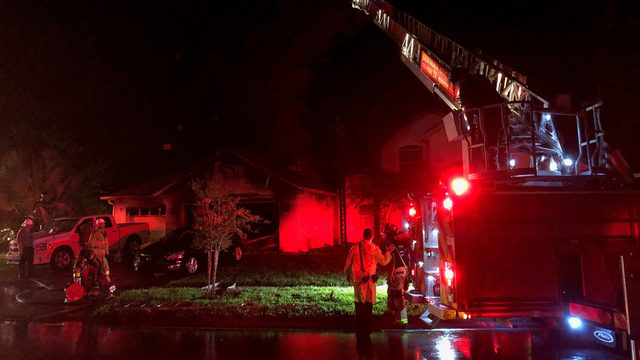 Crews fight huge house fire in Titusville