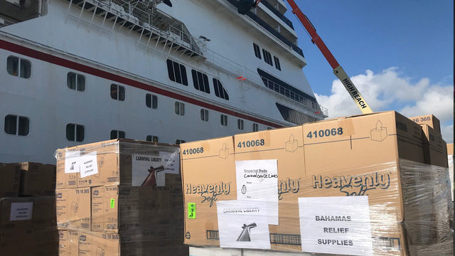 Port Canaveral workers load cruise ship to help Dorian victims in Bahamas