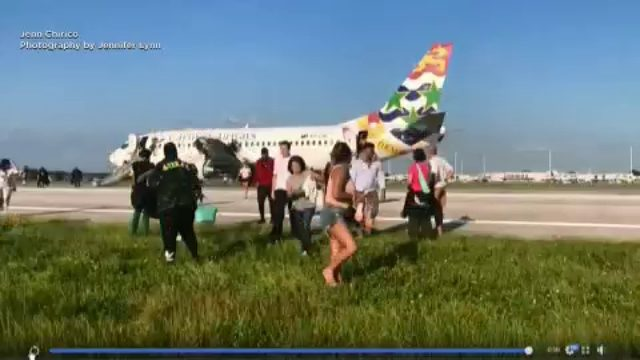 Passengers use emergency slides at OIA