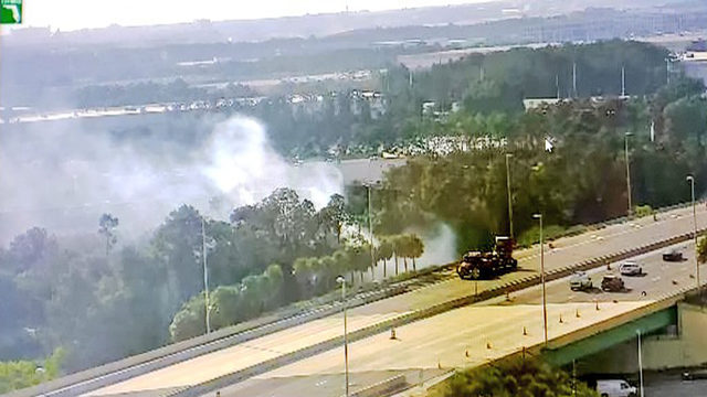 Crews battle brush fire near Florida's Turnpike in Orange County
