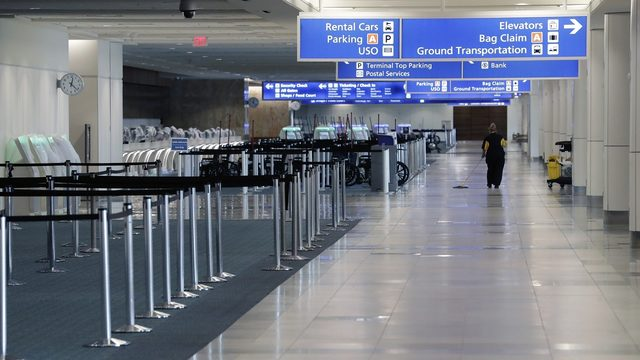 Men smiled while claiming to have bomb in car at airport, police say