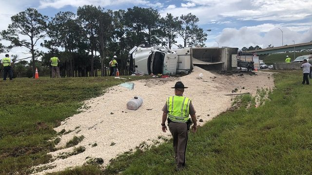 Cement truck overturns, traps driver, closes ramp to Turnpike